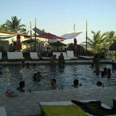 Photo taken at Paparazzi Beach Club by David D. on 2/4/2012