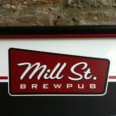 Photo taken at Mill St. Brew Pub by Scott P. on 3/13/2012