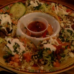 Photo taken at Baja Bar & Grill by S W. on 12/20/2011
