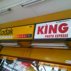 Photo taken at KING PHOTO EXPRESS by Ae G. on 3/11/2012