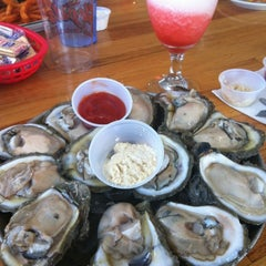 Photo taken at Floyd's Cajun Seafood by Shanael E. on 4/22/2012