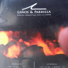 Photo taken at Leños & Parrilla by Mauricio M. on 7/15/2012