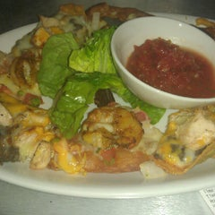 Photo taken at Rumba Rum Bar & Satay Grill by Reci R. on 6/3/2012