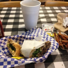 Photo taken at Wholly Cow Burgers by Brian B. on 4/1/2012