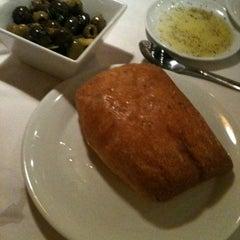 Photo taken at Romano's Macaroni Grill by Matthew W. on 3/18/2012