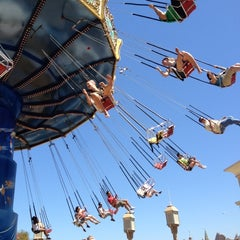 Photo taken at Silly Symphony Swings by Alfred C. on 8/19/2012