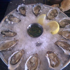 Photo taken at Hog Island Oyster Co. by Irena C. on 9/24/2011