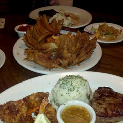 Photo taken at Outback Steakhouse by Vincent R. on 1/19/2012