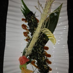 Photo taken at Takara Sushi & Asian Bistro by Virgil M. on 4/28/2012