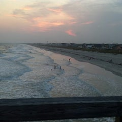 Photo taken at Oak Island Pier by Nate S. on 7/7/2012