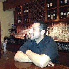 Photo taken at Bistro Mediterranean & Tapas Bar by Jennifer H. on 2/8/2012
