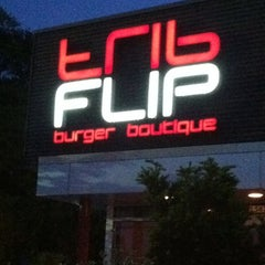Photo taken at FLiP Burger Boutique by April P. on 4/21/2011