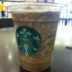Photo taken at Starbucks (สตาร์บัคส์) by อัจฉรา โ. on 2/27/2012
