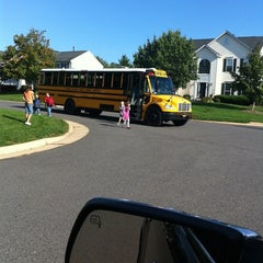 Photo taken at School Bus Stop by Tina K. on 9/29/2011