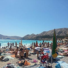 Photo taken at Baška Beach by Velimir M. on 8/8/2012