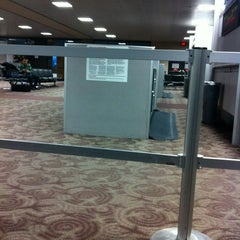 Photo taken at Gate A30 by Bonnie T. on 1/9/2012