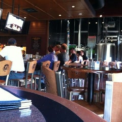 Photo taken at RAM Restaurant & Brewery by Gregory R. on 9/4/2012