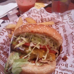 Photo taken at Red Robin Gourmet Burgers by Leering marsupial on 5/27/2012