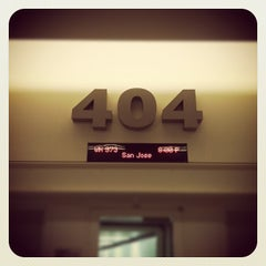 Photo taken at Gate 404 by Roger W. on 11/9/2011