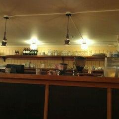 Photo taken at Elliott Bay Café by Don B. on 3/9/2012