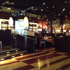 Photo taken at BJ's Restaurant and Brewhouse by Lauren H. on 3/16/2012