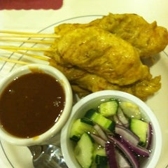 Photo taken at Bangkok Cuisine by Kelly C. on 3/18/2012