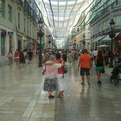 Photo taken at Calle Marqués de Larios by Oscar F. on 8/9/2012