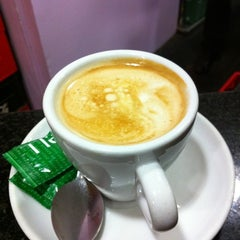 Photo taken at Tucci's Cafe by Jordi M. on 1/26/2011
