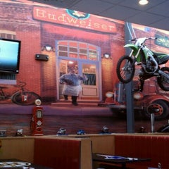 Photo taken at Angry Ham's Octane Bar & Grill by Dawn P. on 4/12/2012