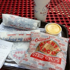 Photo taken at Mighty Taco by Sean S. on 8/12/2011