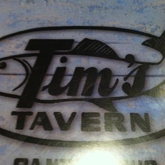 Photo taken at Tim's Tavern by Devin Z. on 7/15/2011