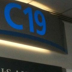 Photo taken at Gate C19 by Joel H. on 8/1/2011