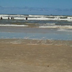 Photo taken at Praia de Imbé by SaMi C. on 1/28/2012