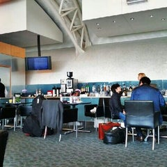 Photo taken at American Airlines Admirals Club by Binny J. on 4/15/2012