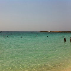 Photo taken at Makronissos beach by Giona C. on 8/1/2012