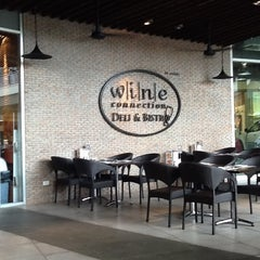 Photo taken at Wine Connection Deli and Bistro by Gems Khanathat P. on 5/13/2012