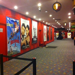 Photo taken at Cines Unidos by Jenny C. on 9/18/2011