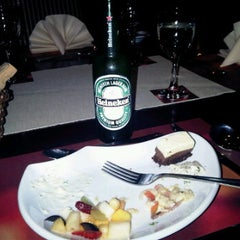 Photo taken at Mei N Yu Restaurant & Lounge by Mike L. on 12/30/2011