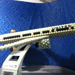Photo taken at United Tennis Ball Plane by Janet F. on 9/9/2011