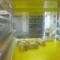Photo taken at Tim's Bakery by Doug V. on 8/11/2012