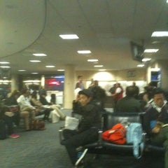 Photo taken at Gate 58A by Chikato Y. on 3/3/2012