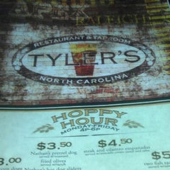 Photo taken at Tyler's Restaurant & Taproom by LaShonia B. on 9/12/2012