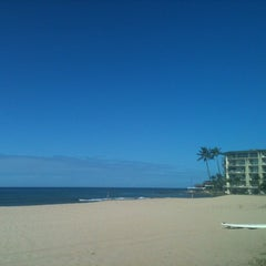 Photo taken at Makaha Beach Park by Leslie-Ann on 8/16/2012