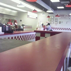 Photo taken at Five Guys by bronze c. on 2/5/2012