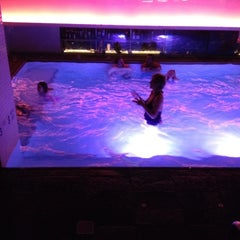 Photo taken at QT Bar & Pool Loung @Grace Hotel by Erica A. on 12/28/2011