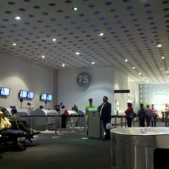Photo taken at Sala/Gate 75 by Frank C. on 9/13/2012