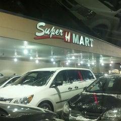 Photo taken at Super H Mart by Sean K. on 2/12/2012