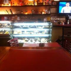 Photo taken at John John Cafe by Marcelo S. on 7/28/2011