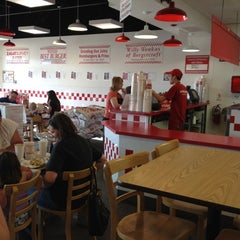 Photo taken at Five Guys by Jen N. on 5/5/2012
