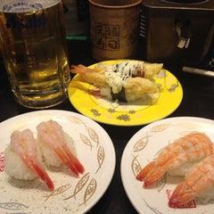 Photo taken at 廻る元祖寿司 下北沢駅前店 by norikashigeta on 1/1/2012